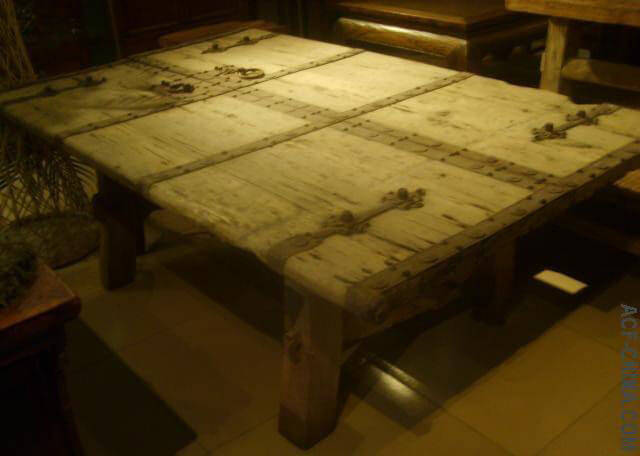 Tabletop of a lounge style coffeetable, made from an old door.