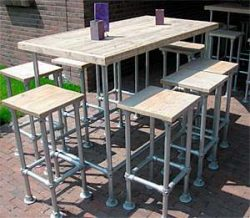 Outside bar and matching stools made from scaffold tubes with planks.