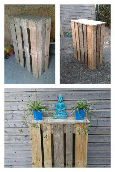 Pallets and scaffold planks were used to make these high tables for outside at a garden bar.