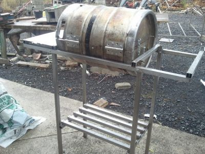 Barrel barbecue and homemade support table frame.