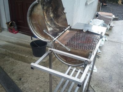 BBQ made from a beer barrel, repurposed as grill.