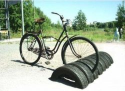 Repurposed car tires as stand for bicles.