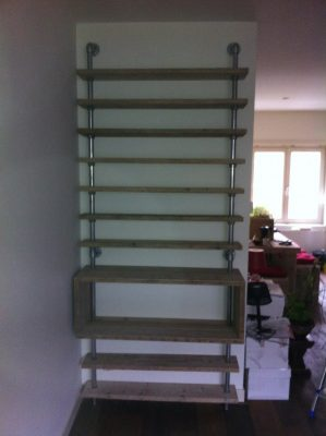 Bookshelf made from old scaffolds.