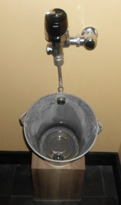 Bucket as sink, cheap and original.