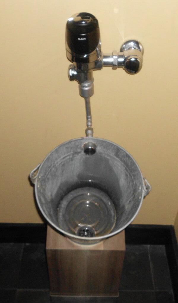 Bucket as sink, cheap and original.