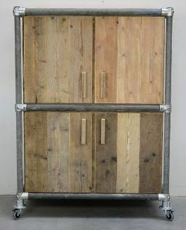Wooden chest with external steel frame on wheels.
