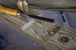 Use a sharp chisel to remove the surplus wood chips.