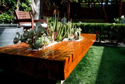 Planter table with integrated space for succulents.