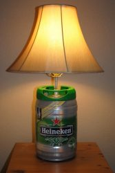 Lampshade fitted on top of a mini keg Heineken beer.