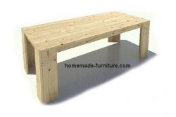 Natural colored homemeade dining table of scaffolding planks.