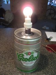 Mini barrel from grolsch beer in use as a table lamp foot.