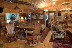 Log house interior with home made furniture from logs and branches.