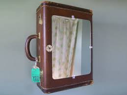 Recycled suitcase in use as a medicine cabinet in the bathroom.