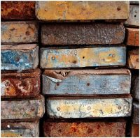 Scaffolding planks weathered with rusty ends.
