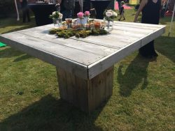 Square garden table design with a planter in the center of the tabletop.
