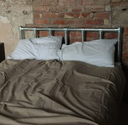 Industrial design beds made from pipes.