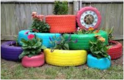Brightly painted tires repurposed as flowerbed.