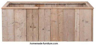 Recatangular planter home made from scaffolding wood.