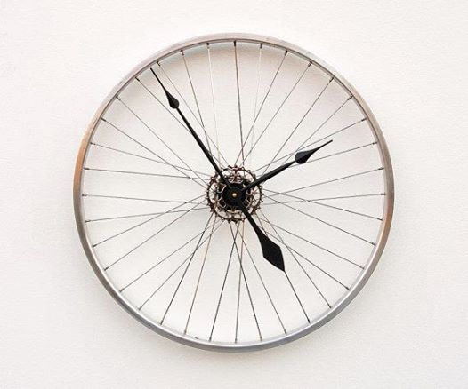 Clock made from an old bicycle wheel.