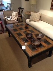 Repurposed door as tabletop for a coffee table in lounge style.