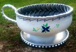 Great idea, inside out tire in shape of a cup, as garden planter.