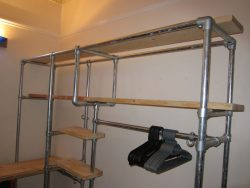Wardrobe made from scaffolding pipes and reclaimed wood.