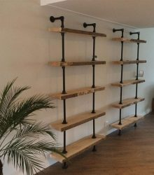 Shelf construction with scaffolding tubes and old scaffold planks.
