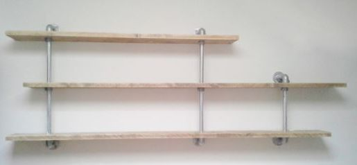 Shelves on a frame from scaffolding tubes.