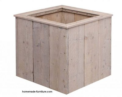 Square wooden planter made of scaffold planks.