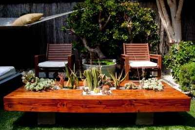 Garden lounge table with integrated planter.