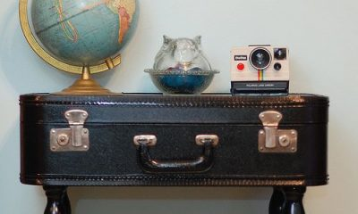Small side table made with a repurposed leather suitcase.
