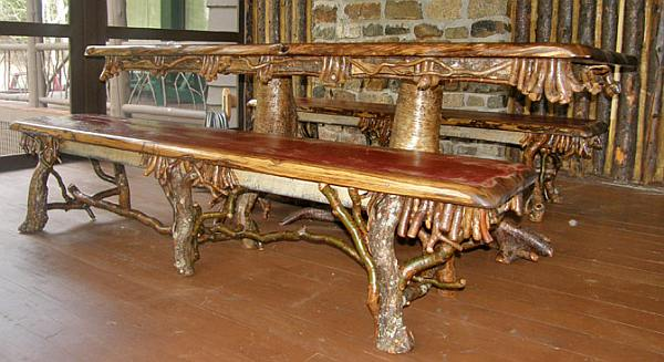 Farmhouse table made from old tree trunk and branches fitted with a pointed dowel wood joint.