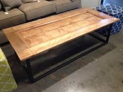 This repurposed table was made with the wood of an antique farm door.