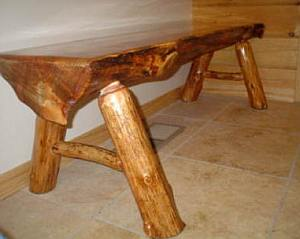 Coffee table made from a halved tree trunk and branches for the legs.