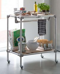 Trolley with shelves, made from scaffold tubes.