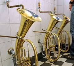 Trombones recycled to make urinals in a jazz cafe.