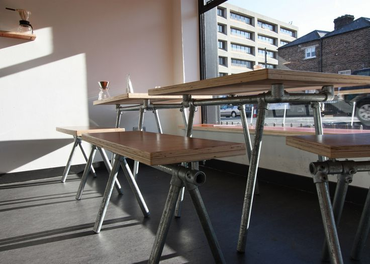 Steel tube frame table and bench from old scaffolding pipes and repurposed wood.