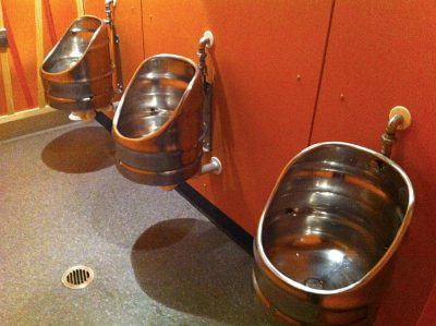 Three urinals made with recycled beer barrels.
