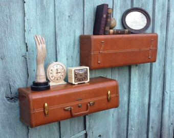 Vintage suitcases fixed to the wall as shelves.