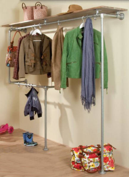 Hallway coat hanger and wardrobe made from scaffold pipes and reclaimed wood.